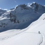 Skier touring in the Selkirk Mountains in British Columbia