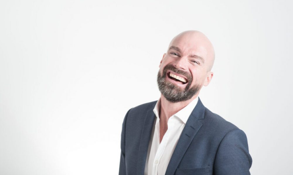 Adult Bald Man Laughing on White Background